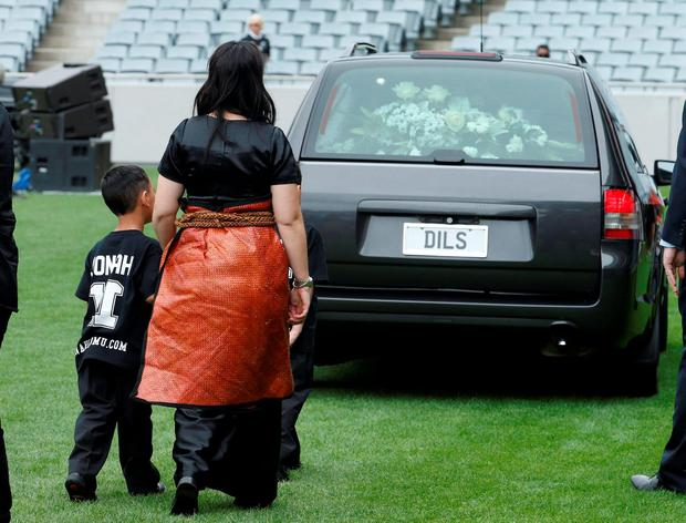 Former All Black Jonah Lomu's widow Nadene Lomu and her children follow his casket out of Eden Park during his memorial service in Auckland, New Zealand, November 30, 2015