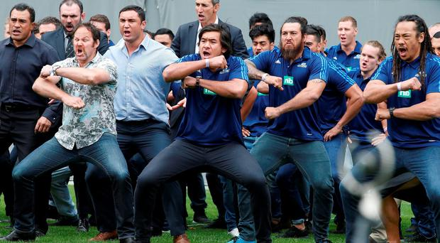 Former and present All Black's perform a Haka as former All Black Jonah Lomu's casket is carried out of Eden Park during his memorial service in Auckland, New Zealand, November 30, 2015