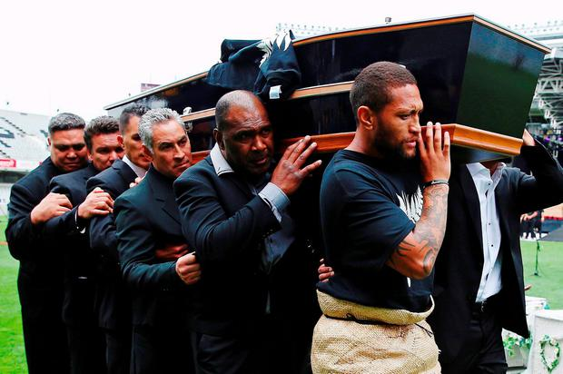 An official party carrries the casket of former All Black player Jonah Lomu during a memorial service at Eden Park in Auckland, New Zealand November 30, 2015