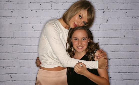 Taylor Swift with fan Jorja in Australia. Picture: Maitland Mercury/Twitter