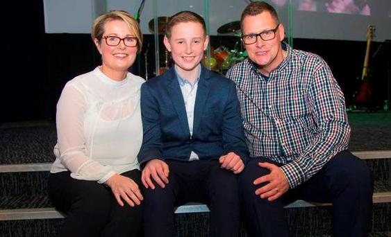 Joshua with his mum Kim and dad Tim