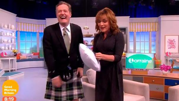 Lorraine Kelly gets very excited with Piers Morgan's pillow birthday gift