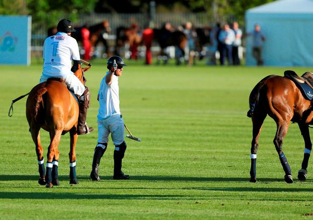 Prince Harry (centre) takes part in a fundraising polo match in aid of his charity Sentebale at the Val de Vie Estate in South Africa