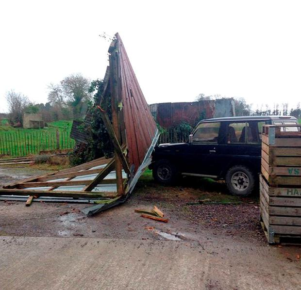 Damage caused to a Toyota truck in the yard after a shed roof crashed into it after Storm Clodagh in Slane, Co. Meath, Ireland yesterday. Photo: Ruby Jenkinson/PA Wire
