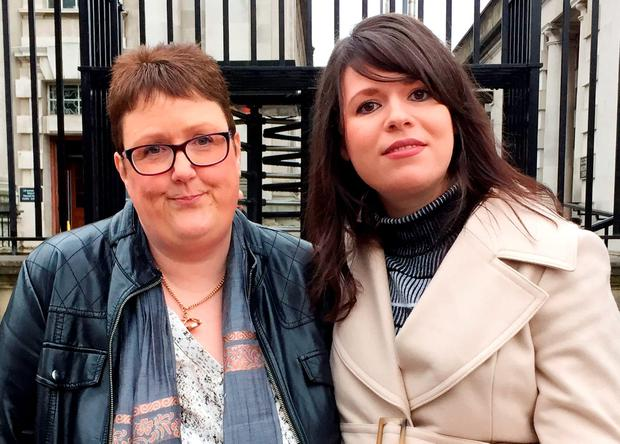 Jane Christie (left) whose daughter Sarah Ewart was forced to travel to England for an abortion after being told her baby had no chance of survival outside the womb, stands with Grainne Teggart from Amnesty International, outside Belfast High Court following a successful challenge to abortion law in the region