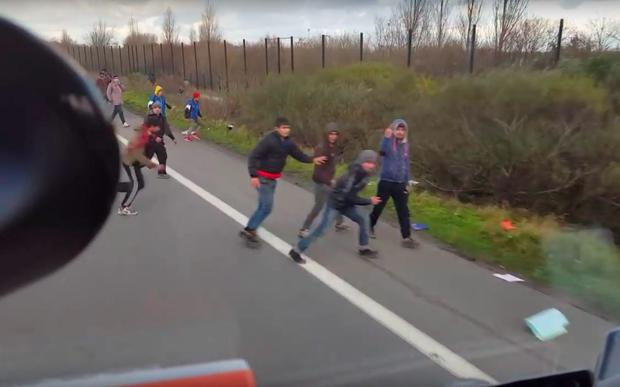 The moment the lorry swerves into one group of migrants Credit: Á. Levente Jeddi \ YouTube