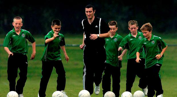 Legendary League of Ireland striker Jason Byrne puts Clonmel Town's U-12s through their paces in 2005 including Ian Fahey, Michael Quinlivan and Seamus Kennedy who won the Munster SFC title on Sunday as well as Padraig Quinlivan and Colman Kennedy