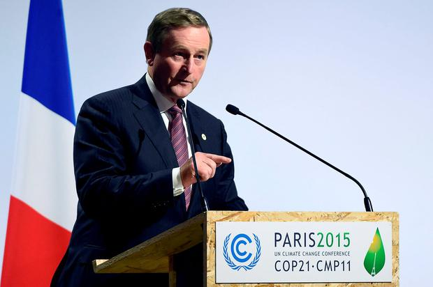Taoiseach Enda Kenny delivers a speech during the opening day of the World Climate Change Conference 2015