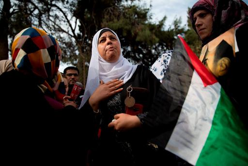 Suha Abu Khdeir, mother of Mohammed Abu Khdeir, center, reacts after the reading of the verdict in his killing, at the Jerusalem District Court. AP Photo