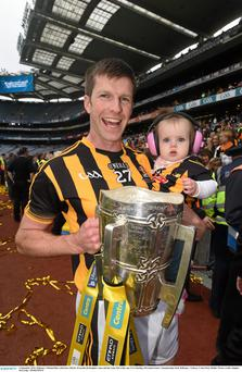 Kilkenny's Michael Rice celebrates with his 10 month old daughter Anna and the Liam McCarthy cup in September
