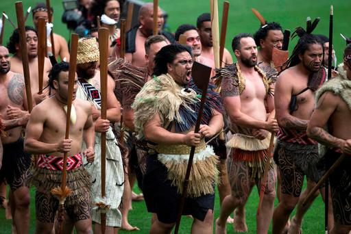 Maori war party performers move around Eden Park during a public memorial to remember New Zealand rugby legend Jonah Lomu in Auckland, New Zealand. (Brett Phibbs/New Zealand Herald via AP)