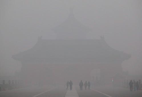 A view shot inside the Temple of Heaven park shows the Temple of Heaven (rear) is barely visible amid heavy smog in Beijing, China, December 1. Reuters/Stringer