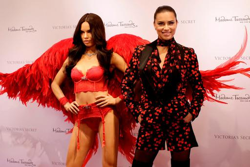 Victoria's Secret model Adriana Lima poses with her Madame Tussaud's wax likeness at a reveal event at the Victoria's Secret store in Manhattan