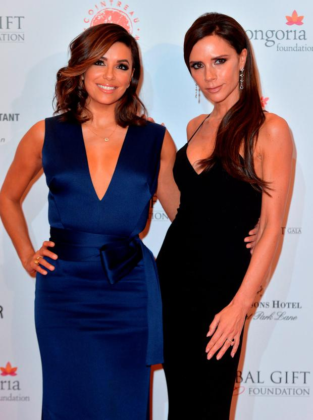 Eva Longoria and Victoria Beckham attend The Global Gift Gala at Four Seasons Hotel on November 30, 2015 in London, England. (Photo by Anthony Harvey/Getty Images)