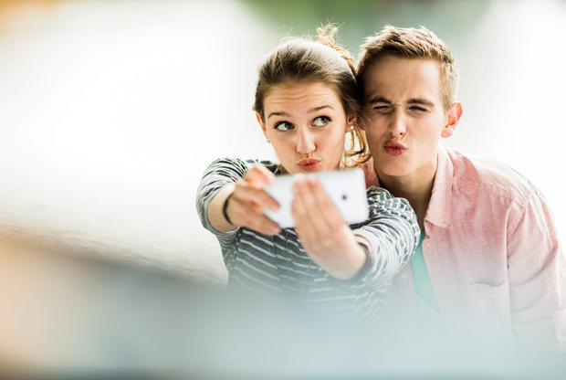 Young couple taking a selfie with smartphone