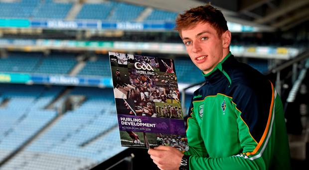 Clare defender David McInerney reading over the Hurling Development Committee's action plan which was launched in Croke Park yesterday