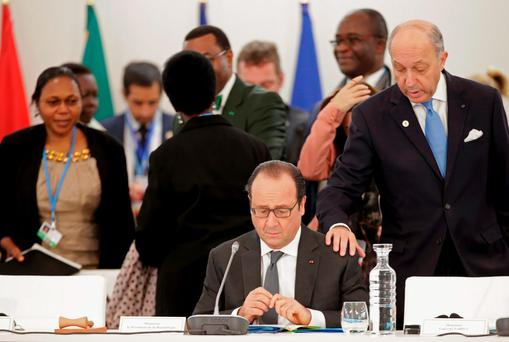French President François Hollande (left) with Foreign Affairs Minister Laurent Fabius at COP21. Photo: Philippe Wojazeraim