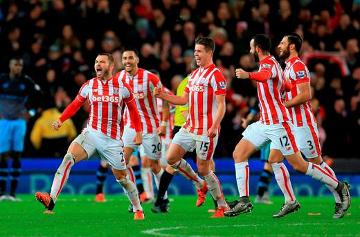 Stoke City's Phillip Bardsley (left) celebrates with his team-mates after scoring his side's second goal during the Capital One Cup, Quarter Final at the Britannia Stadium, Stoke-on-Trent