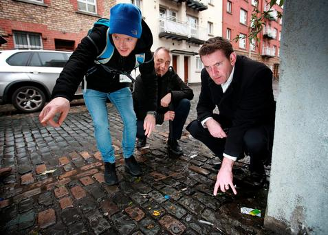 Minister Aodhán Ó Ríordáin (on right) points to discarded needles on Dublin's North Lotts during a tour with Tony Duffin, director of the Ana Livia Drugs Project (centre) and one of its team leaders, Paul Duff. Photo: Frank McGrath