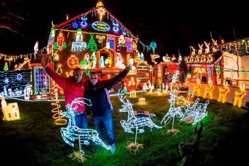 Brothers Lee (left) and Paul Brailsford beside their mother's house in Brentry, Bristol, where they illuminate their mother's house with thousands of festive bulbs and displays for charity. Photo: Ben Birchall/PA Wire
