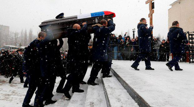 Fellow pilots acting as pall bearers carry the coffin holding the body of Oleg Peshkov, a Russian pilot of the downed SU-24 jet, during a memorial service in Lipetsk, Russia, December 2, 2015. Peshkov was awarded the Hero of Russia award posthumously