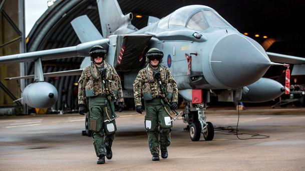 An aircrew with their Tornado GR4 at RAF Marham as they prepare for a practice mission