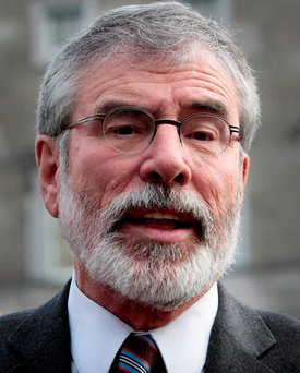 Gerry Adams,TD,the Sinn Fein President speaking to the media ahead of the launch of the Sinn Fein Travellers Rights Private Members Bill at Leinster House yesterday. On left is Pearse Doherty,TD Pic Tom Burke 3/11/2015