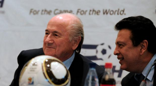 FIFA president Joseph Blatter (L), talks with Alfredo Hawit, Honduras' National Football Federation