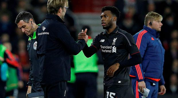 Liverpool's German manager Jurgen Klopp (L) shakes hands with Liverpool's Daniel Sturridge as he leaves the pitch after being substituted during the English League Cup quarter-final football match between Southampton and Liverpool