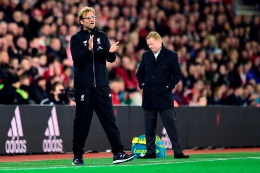 Liverpool Jurgen Klopp (left) encourages his side as Southampton manager Ronald Koeman (right) looks dejected