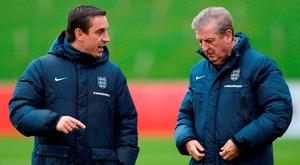 Roy Hodgson manager of England (R) and coach Gary Neville