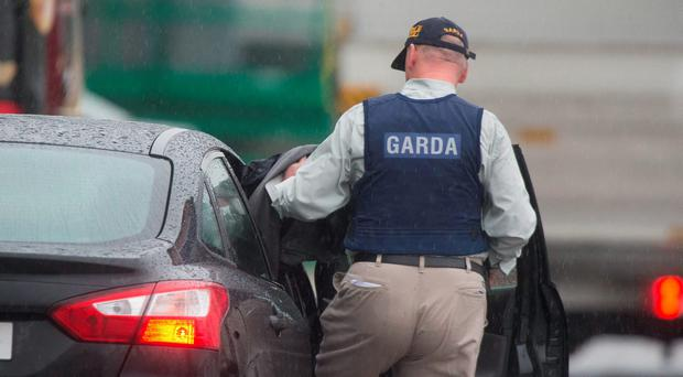 A garda at Dublin Airport earlier today. Photo: Colin O'Riordan