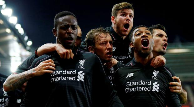 Divock Origi celebrates with team mates after scoring the fourth goal for Liverpool Reuters / Eddie Keogh