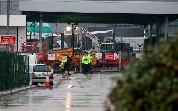 Airport police officers as armed gardai approach a security cash in transit van in the cargo area of Dublin Airport this morning Picture Colin Keegan, Collins Dublin.