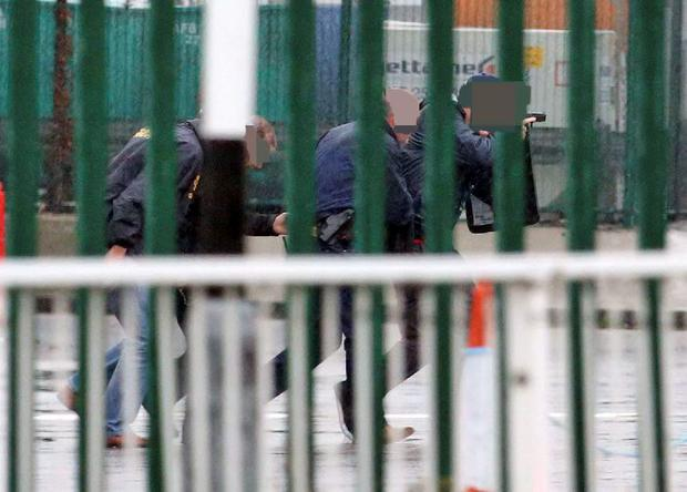 Armed Gardai approach a security cash in transit van in the cargo area of Dublin Airport Picture Colin Keegan, Collins Dublin.