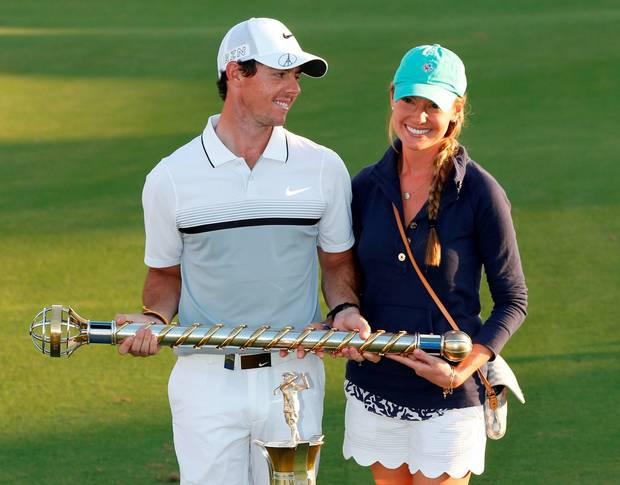 Rory McIlroy celebrates with Erica Stoll after winning the DP World Tour Golf Championship in Dubai