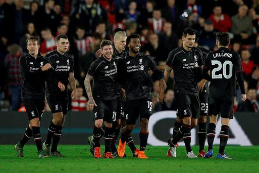 Liverpool's defender Alberto Moreno celebrates with Liverpool team-mates