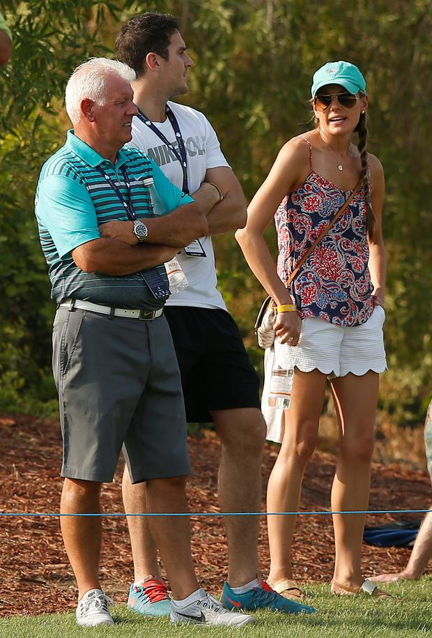 Erica Stoll, girlfriend of Northern Ireland's Rory McIlroy, talks with Gerry McIlroy (left). Photo: Reuters / Paul Childs
