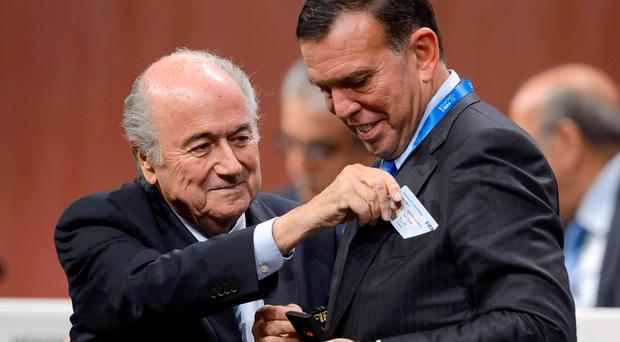 Sepp Blatter (L) and the indicted South American Football Confederation (CONMEBOL) president Juan Angel Napout during the 65th FIFA Congress. E Getty Images