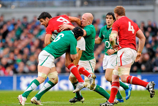 Mike Phillips, Wales, is tackled by Stephen Ferris and Paul O'Connell