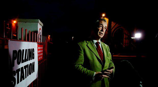 Ukip Leader Nigel Farage talks to reporters before a visit to a local polling station during the final few hours of voting in today's Oldham West and Royton by-election