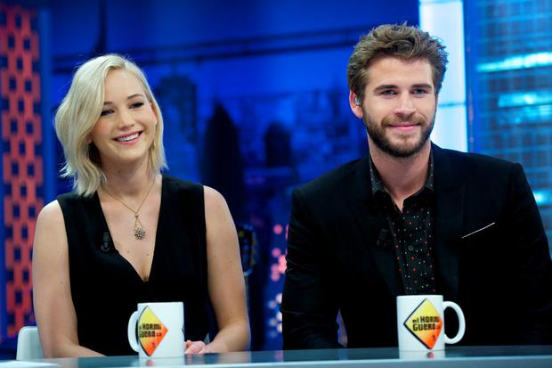 (L-R) Jennifer Lawrence and Liam Hemsworth attend 'El Hormiguero' Tv show at Vertice Studio on November 26, 2015 in Madrid, Spain. (Photo by Juan Naharro Gimenez/Getty Images)