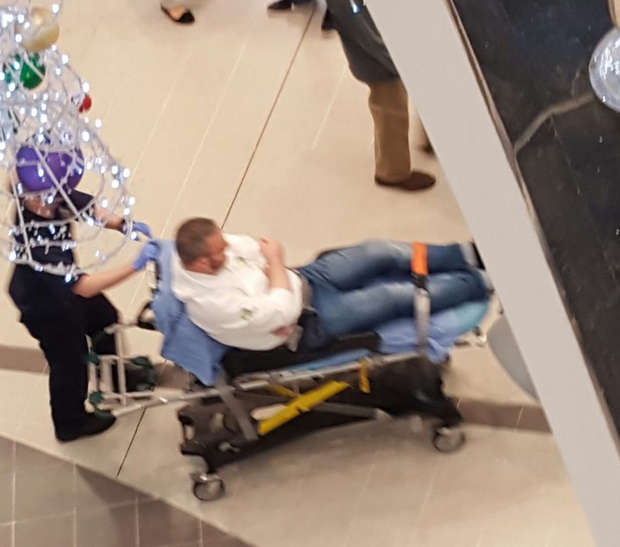 The sales rep is taken away on a stretcher Credit:Twitter/@tobybourke