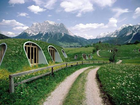 The hobbit homes fit seamlessly into the landscape Credit: Green Magic Homes website