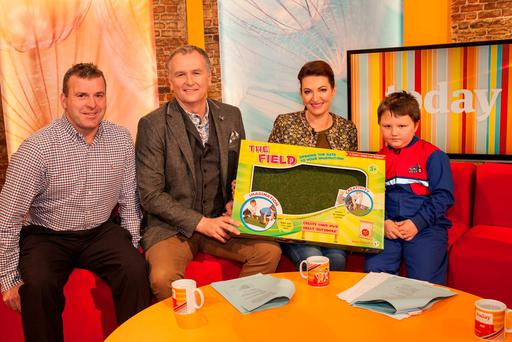 Padraic Cuddy, creator of 'The Field' with Daíthí O'Shea & Maura Derrane presenting rapping farmer, Fionn Molloy with his very own Field on RTÉ's Today with Maura and Daíthí.