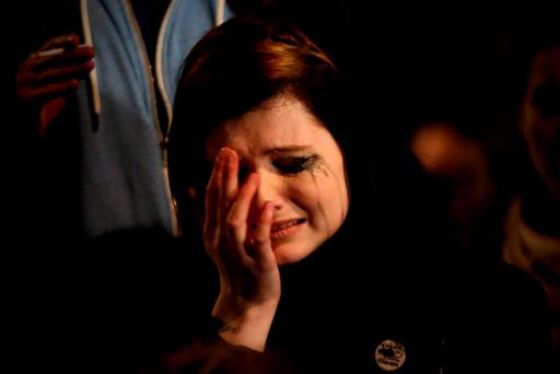 A woman weeps outside Britain's House of Parliament this week after a vote was taken to bomb Syria. Getty