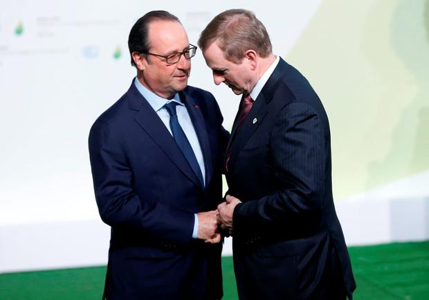 President Hollande meets Taoiseach Enda Kenny at the opening of the conference