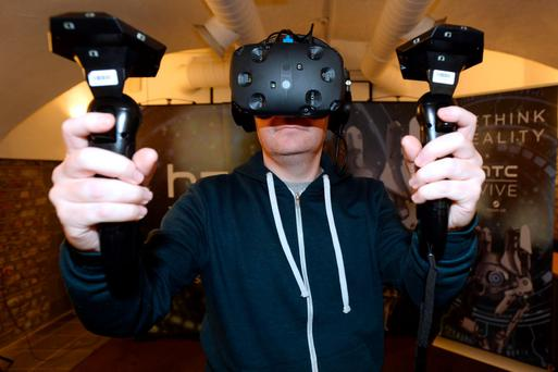 Ronan Price tries out the HTC Vive virtual reality simulator. Photo: Justin Farrelly
