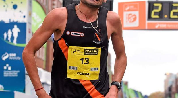 Sergiu Ciobanu crosses the finish line as the first Irish finisher in the men's race at the SSE Airtricity Dublin Marathon 2014