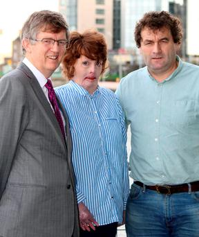 Joanne McMahon with her friend Liam Woulfe (left) and husband Mike McMahon. Photo: Press 22